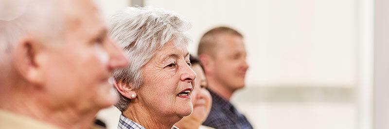 Elderly people in group setting