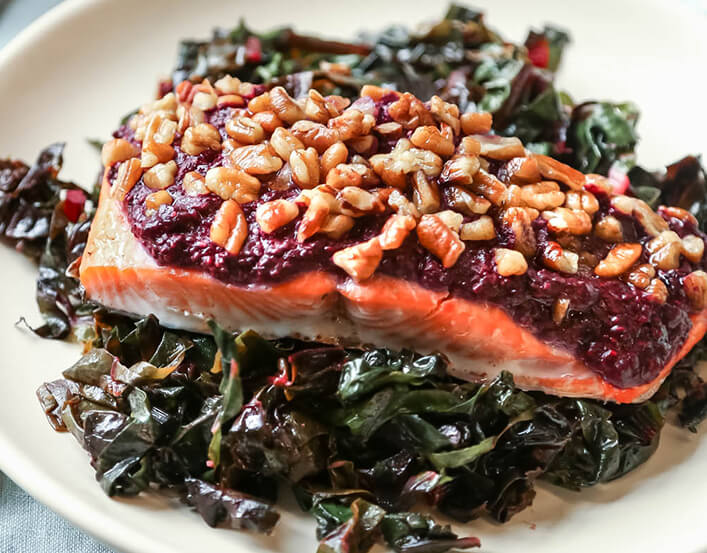 Salmon on bed of wilted greens